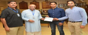 PU VC presents cheque to swimmer Samiullah